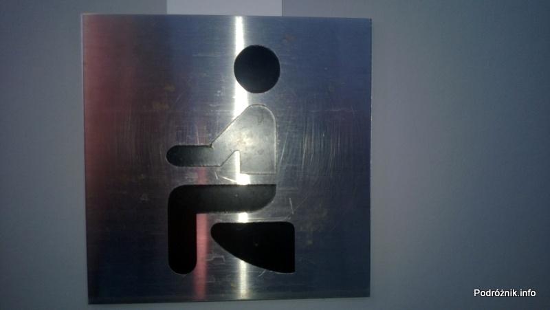 Chiny - Makao - Taipa - symbol toalety z muszlą klozetową - kwiecień 2013