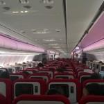 Virgin Atlantic (VS) - Airbus A330 - G-VWAG (Miss England) - wnętrze - widok na klasę ekonomiczną z tyłu samolotu - maj 2014